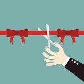 businessman hand cut of ribbon conception