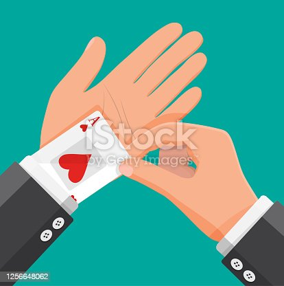 istock Businessman hides aces playing cards in his sleeve 1256648062