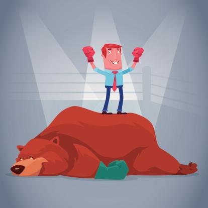 businessman hitting bear