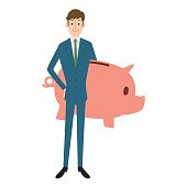 BUsinessman hoiding a Piggy bank.