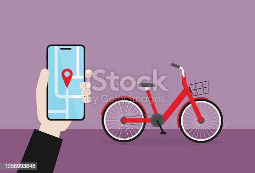 istock Businessman hold a mobile phone for use a bicycle sharing 1256993848