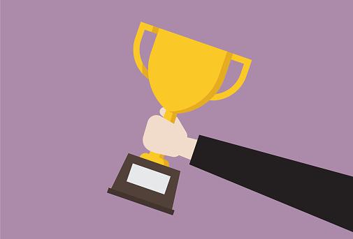 Businessman hold trophy