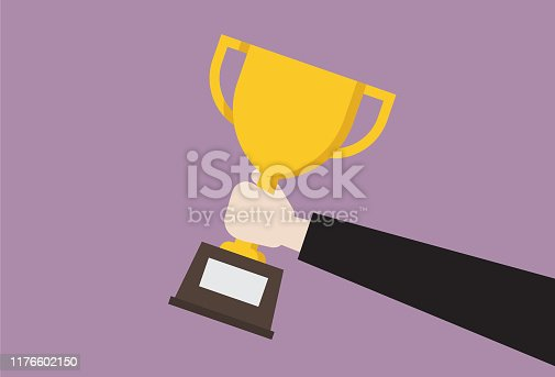 istock Businessman hold trophy 1176602150