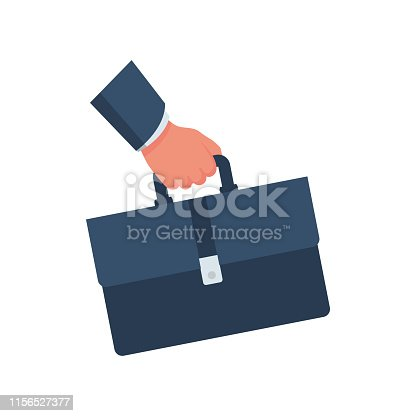 istock Businessman holding a briefcase in hand. 1156527377