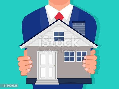 Un hombre de negocios sosteniendo una casa. Aislado en el fondo. vector