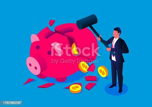 Businessman holding a sledgehammer to destroy a piggy bank