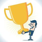 Businessman holding a trophy.