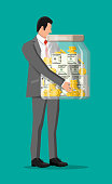 Businessman holding big money box. Glass money jar full of gold coins and dollar banknotes. Growth, income, savings, investment. Symbol of wealth. Business success. Flat style vector illustration.