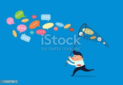 Businessman holding net to catch conversation bubble