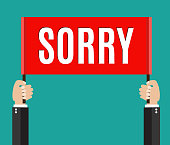 Businessman holding sorry sign