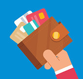 istock Businessman holding wallet full of credit cards 1060466166