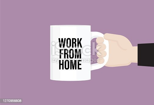 """istock Businessman holds a coffee cup with """"work from home"""" text 1270956608"""