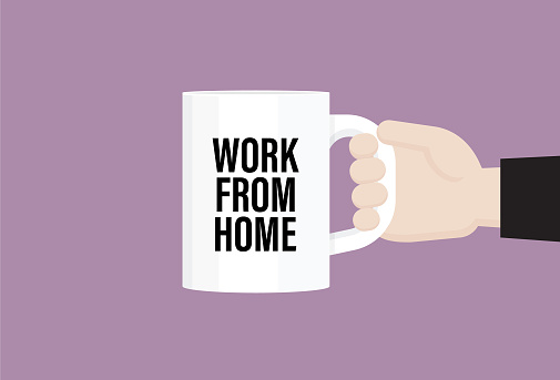 """Businessman holds a coffee cup with """"work from home"""" text"""