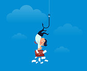 Businessman hooked up by hook and hung in mid air
