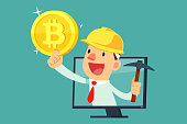 Businessman with mining equipment in computer screen holding bitcoin. Cryptocurrency business concept.