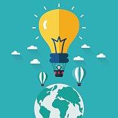 Businessman in hot air balloon made of light bulb idea