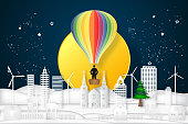 Businessman in the colorful hot air balloon and looking the big full moon in the dark night as business, target, paper art and craft style concept. vector illustration.