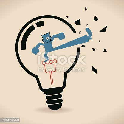 istock Businessman inside light bulb, breaking it to get out 489246768