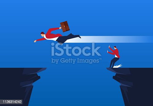 A businessman is afraid to jump over the cliff and another fly over the cliff