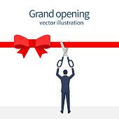 Businessman is holding big scissors cutting red ribbon