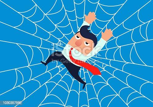 Businessman is stuck on spider we