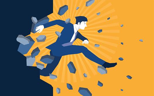 Businessman jump breaking the wall