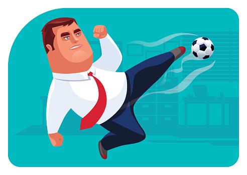 businessman kicking football in office