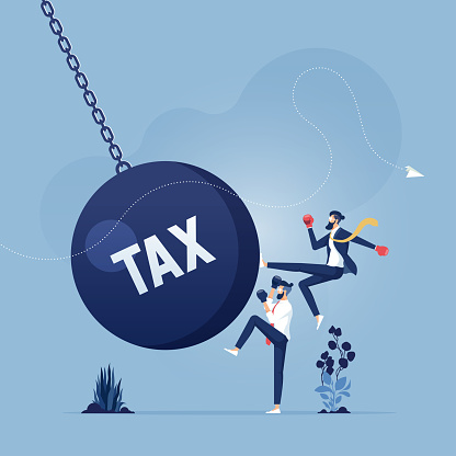 Businessman kicks a giant wrecking ball with a word tax