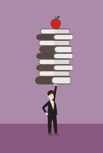Businessman lift stack of book and apple