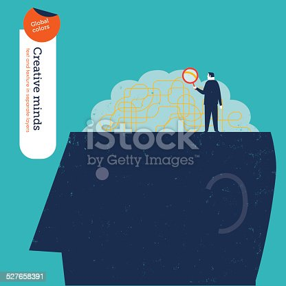 862431374 istock photo Businessman looking at the brain with a magnifying glass 527658391