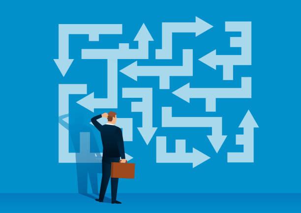 illustrazioni stock, clip art, cartoni animati e icone di tendenza di businessman looking at the labyrinth of arrows looking for the right direction - incertezza