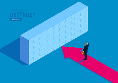 Businessman moving forward arrow blocked by wall