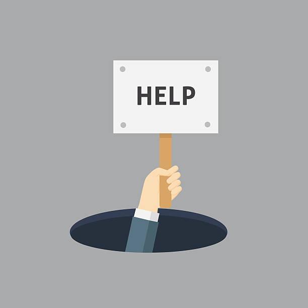 businessman on the hole with help placard - feststecken stock-grafiken, -clipart, -cartoons und -symbole