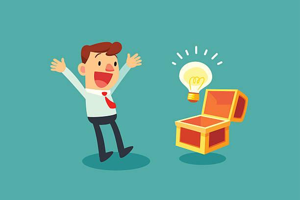 businessman opening treasure chest and discover idea bulb - entdeckungskiste stock-grafiken, -clipart, -cartoons und -symbole