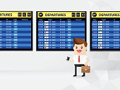 businessman or passenger hold flight ticket and looking at timetable