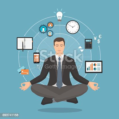 Businessman practicing mindfulness meditation, he is clearing his mind, releasing stress and expressing his potential; yoga and self consciousness concept