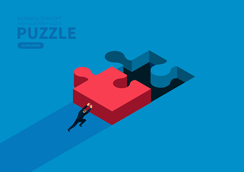 Businessman pushes the puzzle to the right position