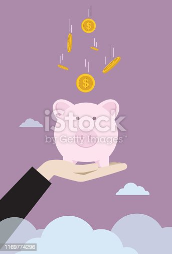 istock Businessman raise piggy bank with falling coin 1169774296