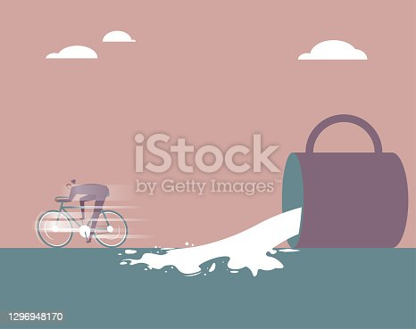 istock A businessman rides a bicycle away in front of the fallen cup. 1296948170