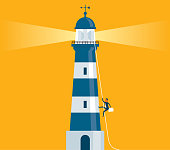Businessman rope climbing a light house