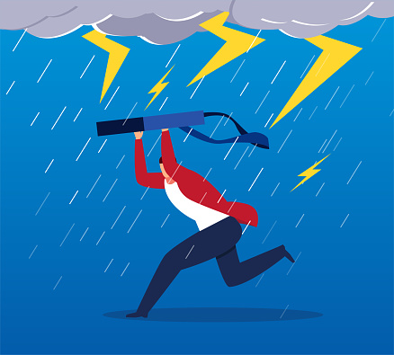Businessman running in the storm