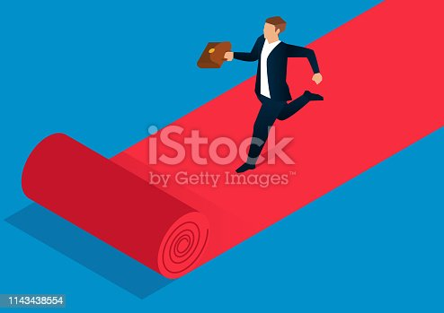 Businessman running on red carpet