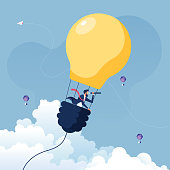 istock Businessman searching for opportunities in hot air balloon light bulb-Business concept vector 1223113343