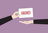 istock Businessman sends a secret envelope 1253272641