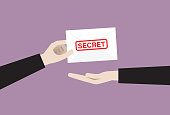 istock Businessman sends a secret envelope 1253272641