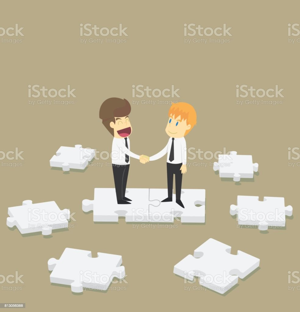 Businessman Shaking Hands On Jigsaw Cooperationbusiness