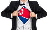 businessman showing North Korea flag underneath his shirt