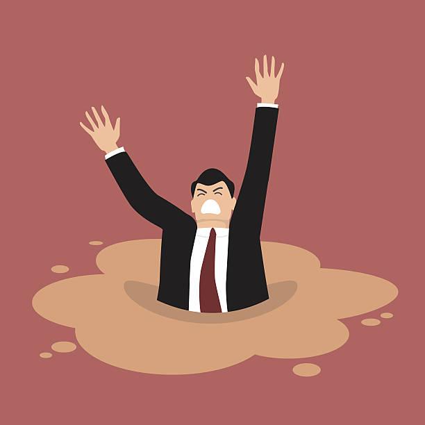 businessman sinking in a puddle of quicksand - gesunken stock-grafiken, -clipart, -cartoons und -symbole