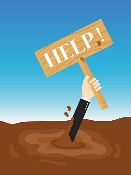 businessman sinking in quicksand holding up wooden sign need help - feststecken stock-grafiken, -clipart, -cartoons und -symbole