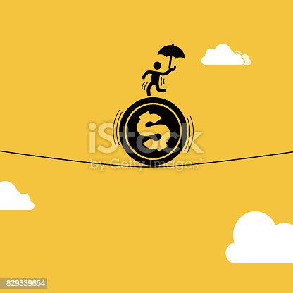 istock Businessman staged acrobatics on the dollar coin 829339654